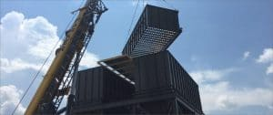 crane holding a large steel structure